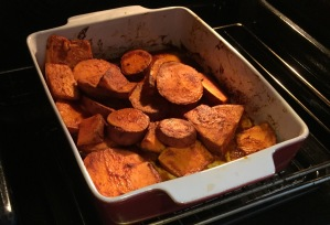 A picture of sweet potato chips baking in the oven
